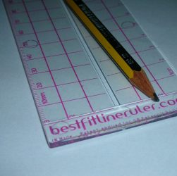 Photo of the Best Fit Line Ruler with a pencil on it
