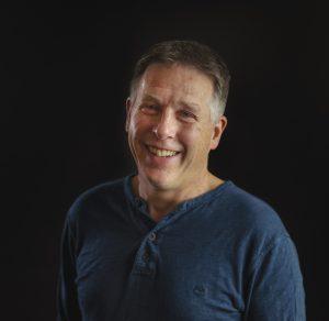 Portrait photo of the author Miles Hudson