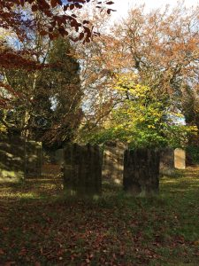 Photo of autumn colours in the graveyard at St Oswald's Church in Durham, England.