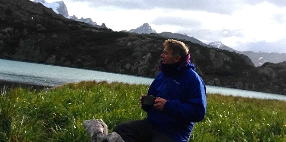 Photo of Miles Hudson camped by a lake near Ushuaia in southern Argentina