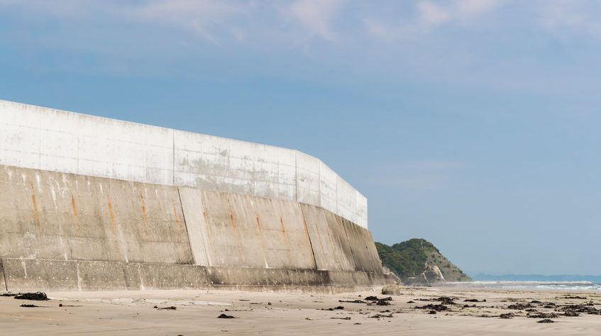 High concrete wall at seaside